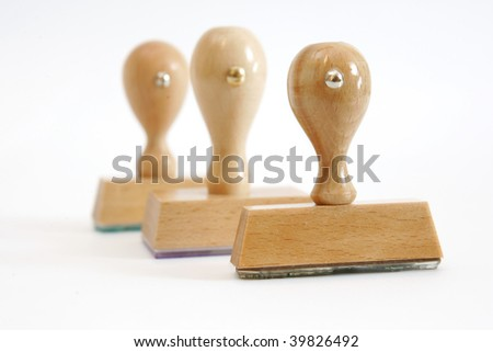 Tree wooden rubber stamps in a row - stock photo
