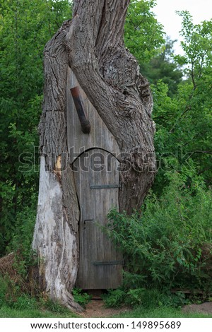 treehouse with stovepipe - stock photo