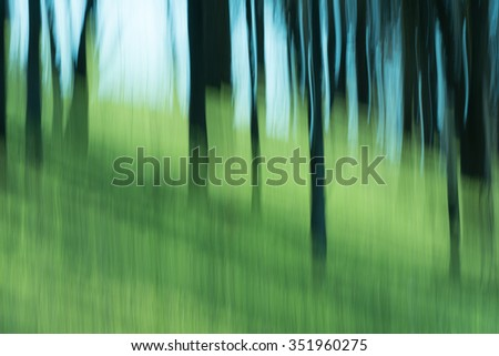 Trees and grass and sky abstract with blur - stock photo