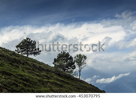 Trees and landscape with dramatic sky in the Caucasus mountains, Georgia, Asia - stock photo