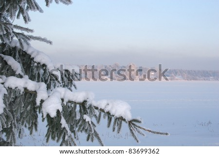 Trees and river on cold frosty winter day - stock photo