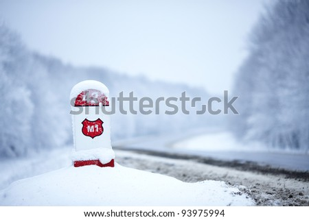 Trees covered with white snow near the road - stock photo