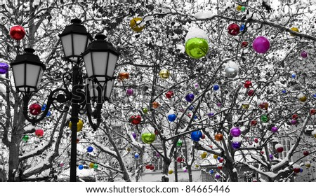Trees decorated with Christmas baubles under the snow. - stock photo