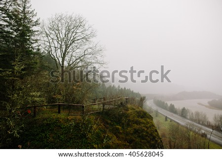 Trees Road and Train Tracks along the Columbia River Gorge - stock photo