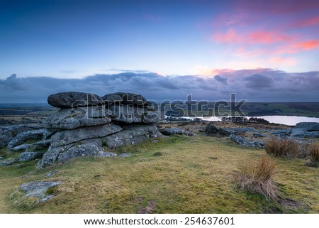 Tregarrick Tor overlooking Siblyback lake on Bodmin Moor in Cornwall - stock photo