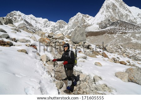 trekker walk to everest basecamp from everest trek nepal - stock photo