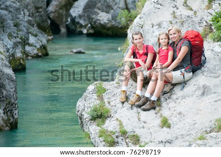 Trekkers - family on mountain trek - stock photo