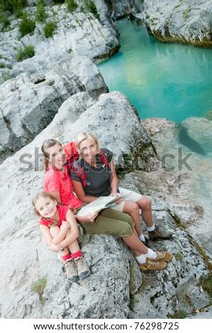 Trekkers - family on mountain trek - stock photo