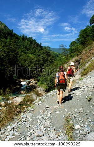 Trekkers in the Himalayan mountains, Annapurna conservation region, Nepal - stock photo