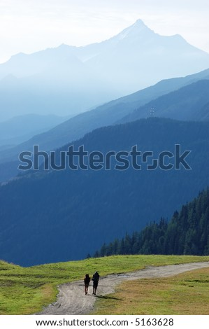 Trekkers walking along a mountain path,Mont Blanc valley, west Alps, Italy. - stock photo