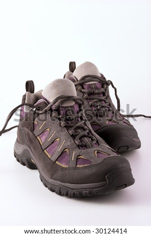 Trekking boots on white background - stock photo