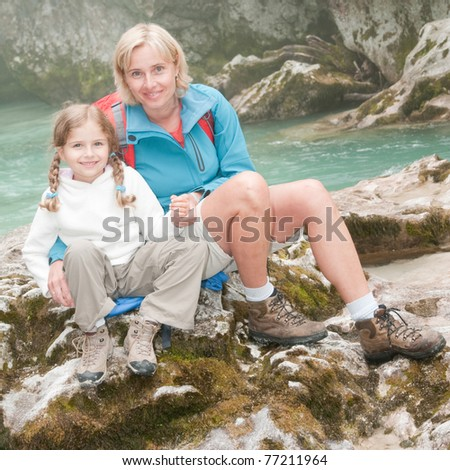 Trekking - girl with mother on mountain trek