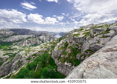 Trekking in Norwegian fjords - view over Lysefjord from a trail to Preikestolen aka the Pulpet Rock (Lysefjord) - stock photo