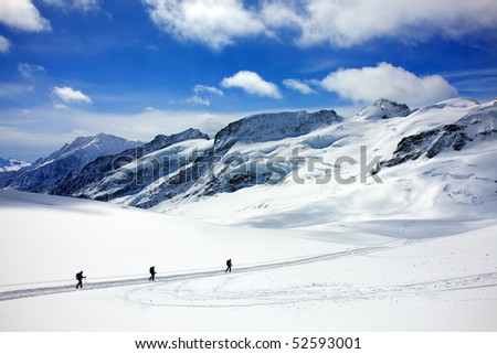 Trekking on the Aletsch Glacier. - stock photo