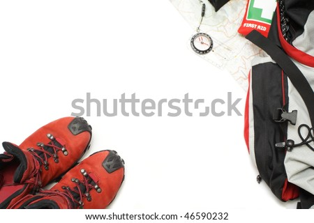Trekking shoes and hiking equipment with map, backpack, first aid kit and compass