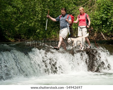 Trekking with dog - stock photo