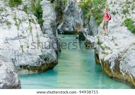 Trekking - young girl on mountain trek - stock photo