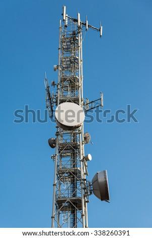 trellis mobile antennas and satellite dishes - stock photo