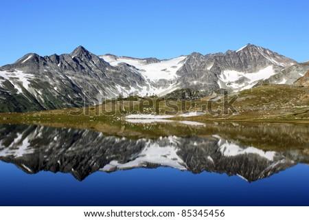 Tremor Mountain and Mount Macbeth reflected in Russet Lake (Garibaldi Park, British Columbia, Canada) - stock photo
