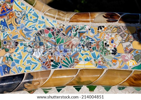 Trencadis abstract mosaic from broken tile shards, part of Serpentine Bench at Gaudi's Park Guell in Barcelona, Catalonia, Spain. - stock photo