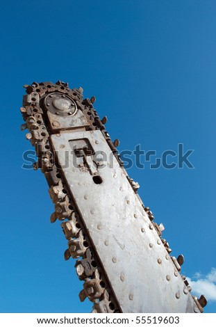 Trench digger on background of blue sky - stock photo
