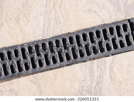 Trench drain linear grate on street closeup  - stock photo