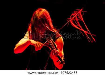 TRENCIN,SLOVAKIA - JULY 5:Violin player of Lou Reed's group performs at the Pohoda Music Festival at the Trencin Airport in Trencin, Slovakia on July 5, 2012.