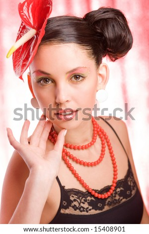 Trend model with a red flower on the head. Ideal skin. With a brilliantly detailed skin. Soft focus.