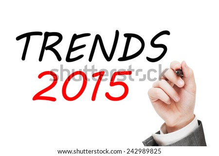 Trends 2015 concept. Man writing a message text on transparent glass isolated on white background - stock photo