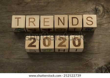Trends for 2020 text on a wooden background - stock photo