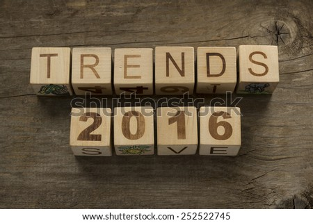 Trends for 2016 text on a wooden background - stock photo