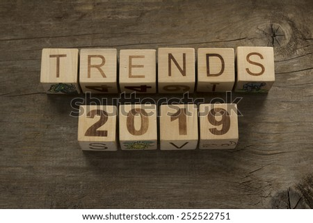 Trends for 2019 text on a wooden background - stock photo