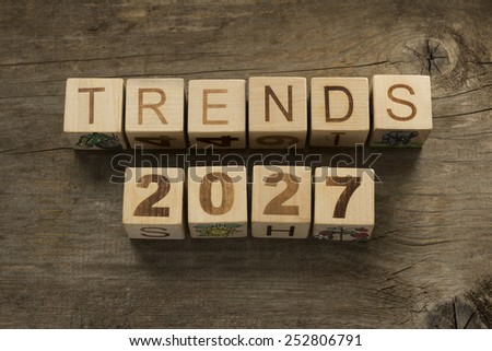 Trends for 2027 text on a wooden background - stock photo