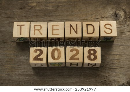 Trends for 2028 text on a wooden background - stock photo