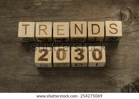 Trends for 2030 text on a wooden background - stock photo