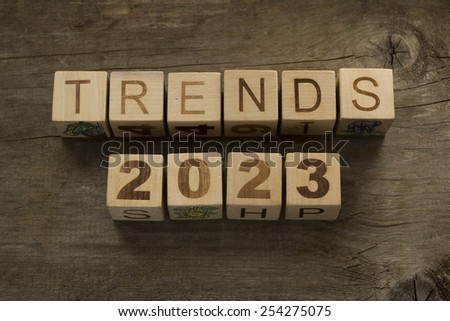 Trends for 2023 text on a wooden background - stock photo