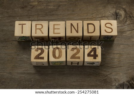 Trends for 2024 text on a wooden background - stock photo