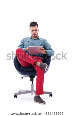 Trendy and young man using digital tablet - stock photo