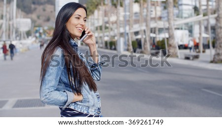 Trendy attractive young woman in a denim outfit - stock photo