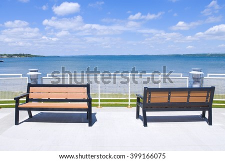 Trendy background with park benches in reverse order - stock photo