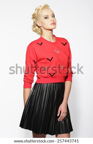 Trendy Blond in Red Blouse and Black Skirt - stock photo