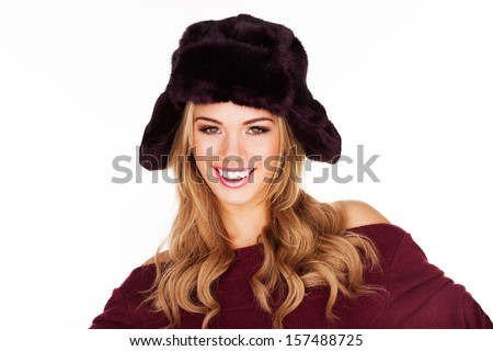 Trendy blond woman in a black hat smiling happily at the camera isolated on white - stock photo