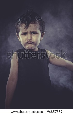 trendy boy dressed rocker with funny faces - stock photo