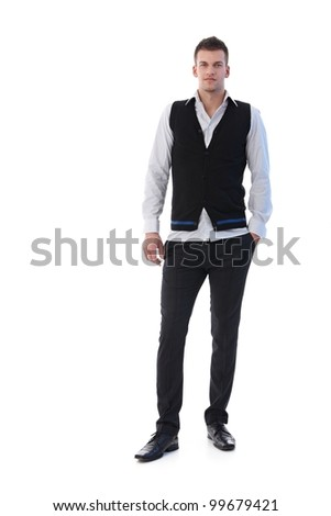 Trendy businessman standing confidently, looking at camera. - stock photo