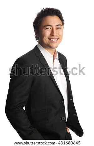 Trendy businessman wearing a black suit and white shirt smiling, looking at camera. White background.
