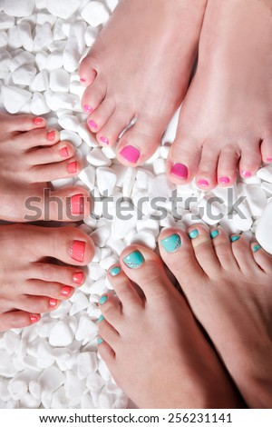 Trendy colorful nail polished toes - stock photo