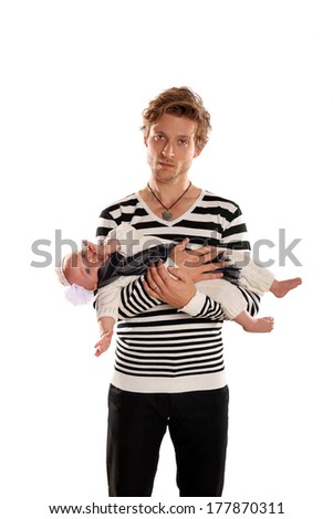 Trendy father holding his baby - stock photo