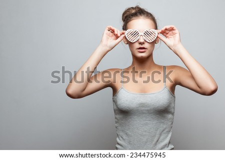Trendy girl in sunglasses and casual clothes - stock photo