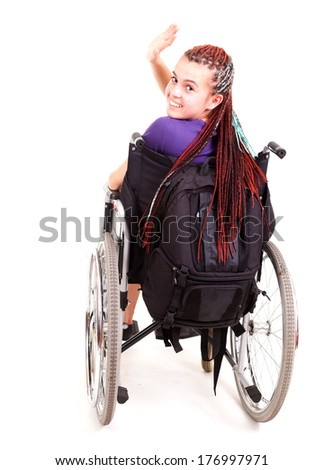 trendy girl on the wheelchair, white background - stock photo