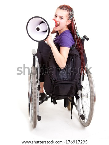 trendy girl with megaphone on the wheelchair, white background - stock photo